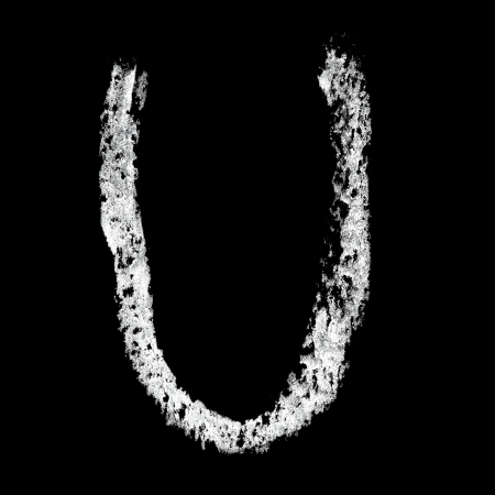 U - Chalk alphabet over black background photo