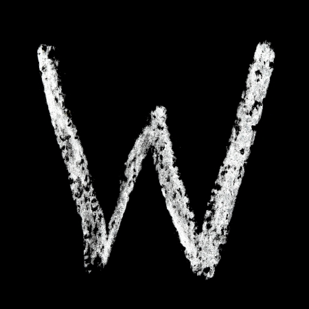 W - Chalk alphabet over black background photo
