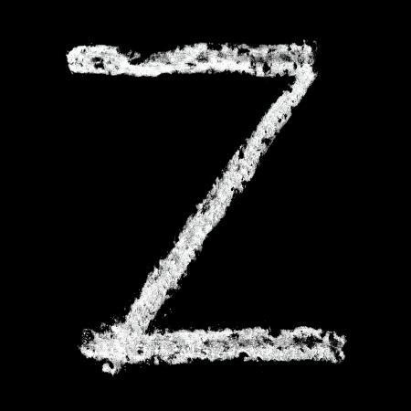 Z - Chalk alphabet over black background photo