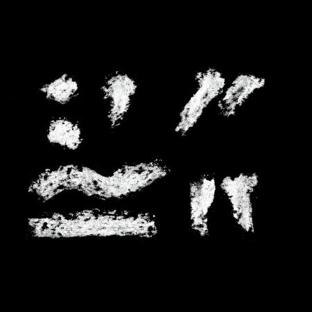Punctuation marks - Chalk alphabet over black background photo