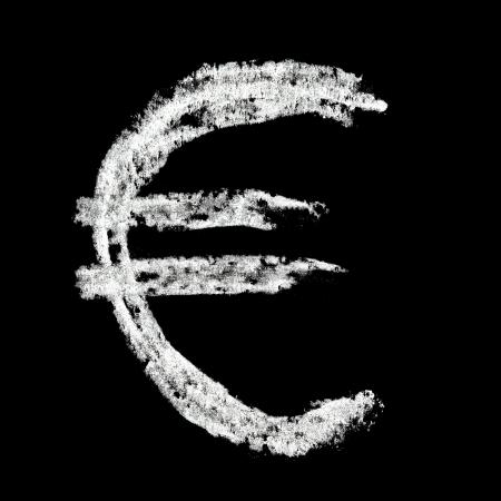 Euro sign - Chalk alphabet over black background photo