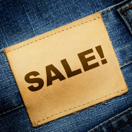 Blue jeans label with word SALE photo