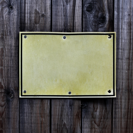 inhibitory: Blank sign over old wooden fence