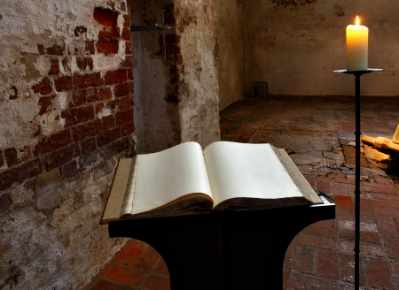commemoration: Open book with blank pages and candle Stock Photo