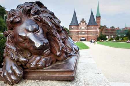 Sleeping lion and Holsten Gate, Lubek, Germany