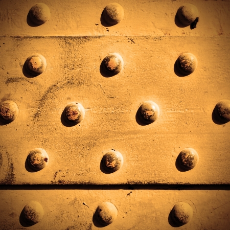 solidity: Metal surface with rivets, may be used as background