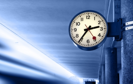 tardiness: Clock at railway station. Toned in blue color.