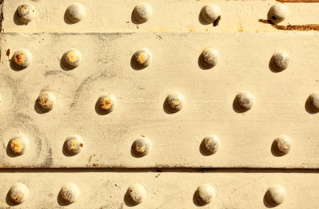 soundness: Metal surface with rivets, may be used as background