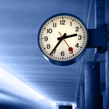 tardiness: Departure of a train from railway station  Toned in blue color