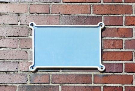 nameboard: Blank sign on red brick wall