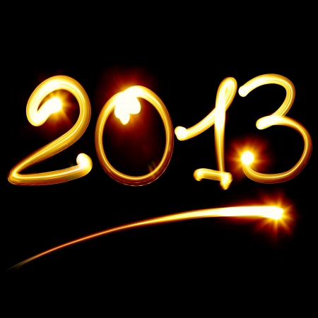 Happy new year 2013 message over black background Stock Photo - 15732590