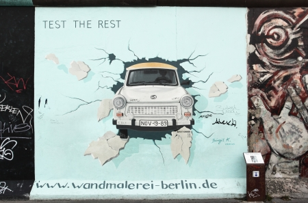 BERLIN - AUGUST 22: Famous painting by Birgit Kinder of the Trabant on Berlin Wall at East Side Gallery August 22, 2012 in Berlin  Stock Photo - 16286250
