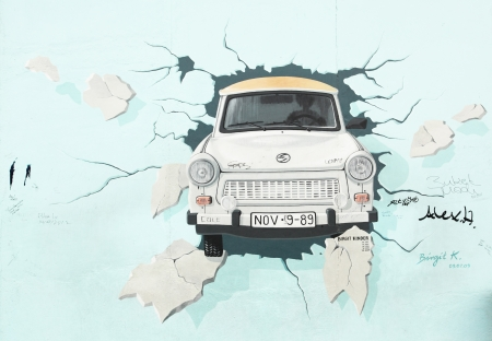 BERLIN - AUGUST 22: Famous painting by Birgit Kinder of the Trabant on Berlin Wall at East Side Gallery August 22, 2012 in Berlin  Stock Photo - 16286245