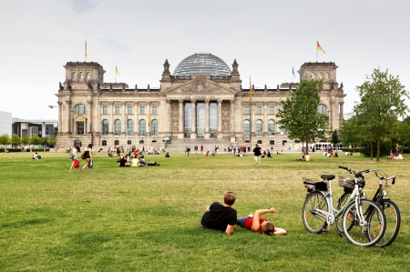 grassplot: BERLIN - AUGUST 21: People are resting near parliament of Germany - Bundestag   August 21, 2012 in Berlin