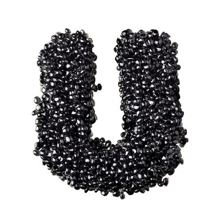 fount: U - Alphabet made from black caviar Stock Photo