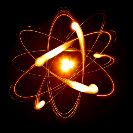 atomic energy: Symbol of atom over black background