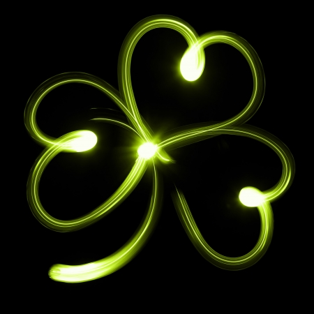Shamrock or clover icon on black background photo