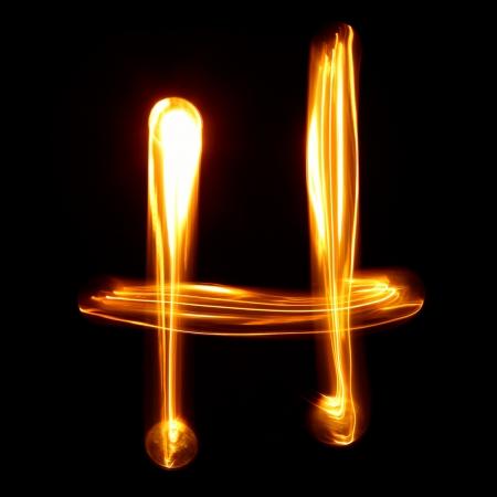 H - Afgebeeld door licht brieven Stockfoto
