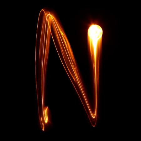flame letters: N - Pictured by light letters