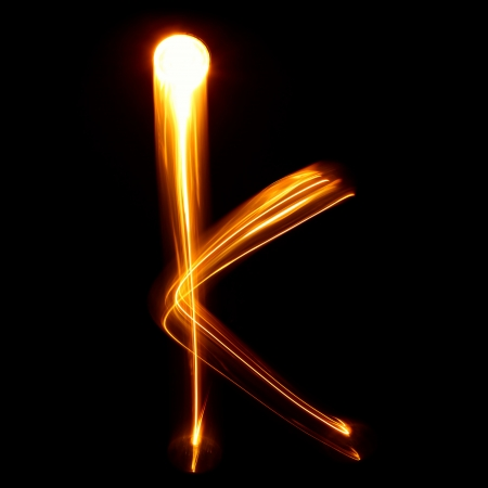 K - Created by light lowercase letters photo