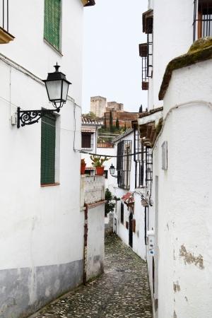 granada: Old narrow street in Granada, Spain