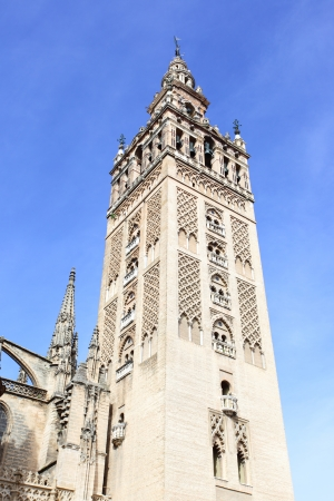 bell tower: Cathedral with Giralda bell tower, symbol of Seville Stock Photo