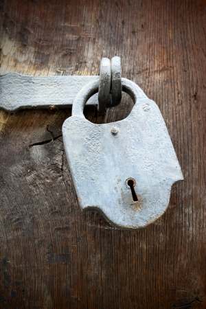 Antique padlock with hasp on a wooden door Stock Photo - 19582599