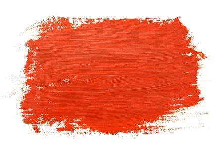 白い背景の上の赤いブラシ ストローク