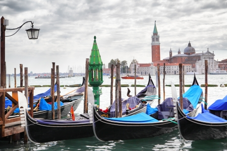 saint marco: Gondolas near Saint Mark square and San Giorgio di Maggiore church in the background - Venice, Italy