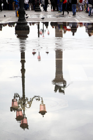 reflects: Venice reflects in puddle, Saint Mark