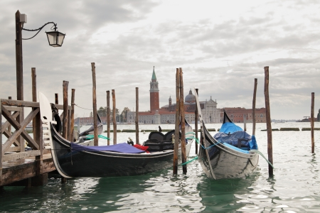 Gondolas and San Giorgio Maggiore church in the , Venice, Italy photo