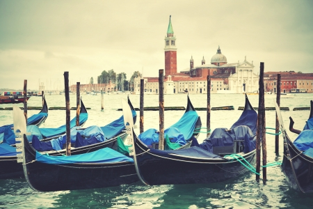 Gondolas and San Giorgio Maggiore church in the background, Venice, Italy photo