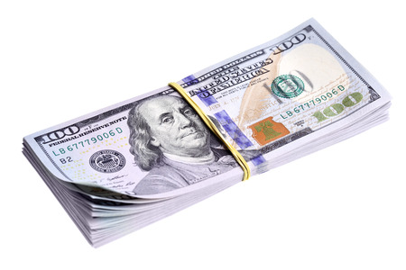 Bundle of new dollars isolated over the white background photo