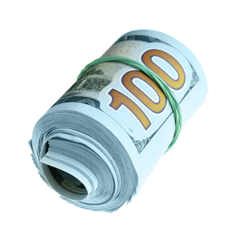 Roll of new hundred dollar bills isolated over the white background photo