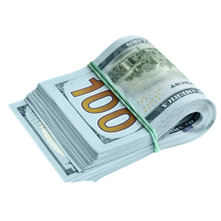Bundle of new hundred dollar bills isolated over the white background photo
