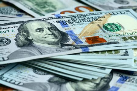 heap of dollar: Bundle of new hundred dollar bills Stock Photo