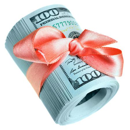 Roll of new hundred dollar bills - Money for gift photo