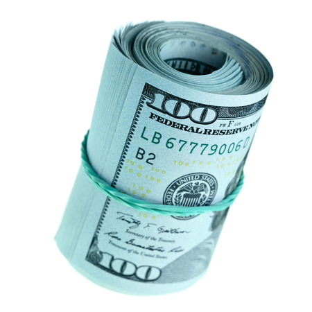 Roll of new hundred dollar bills isolated photo