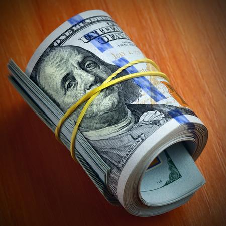 subornation: Roll of dollar bills - Money keeps silent