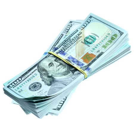 Bundles of dollars isolated over the white background photo