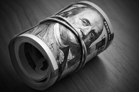 Dollar bills close-up - Money keeps silent Stock Photo