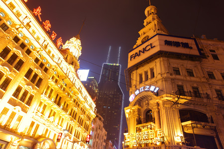 SHANGHAI, CHINA - APRIL 12, 2014  Famous builfings of pedestrian Nanjing Road at night