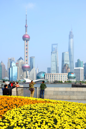 sightseeng: SHANGHAI, CHINA - APRIL 14, 2014  View of Pudong New Area from the Bund waterfront