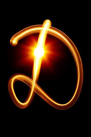 cursive: D - Created by light alphabet over black background
