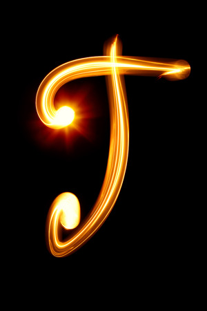 created: T - Created by light alphabet over black background