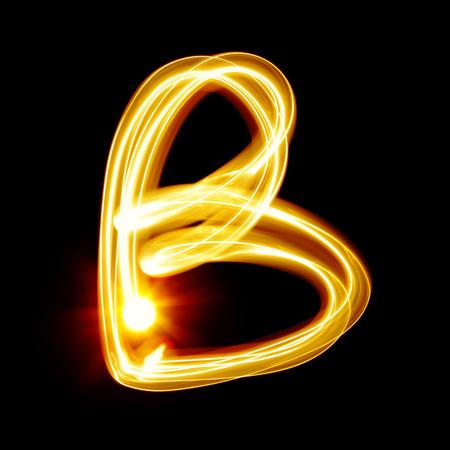 burning alphabet: B - Created by light alphabet over black background