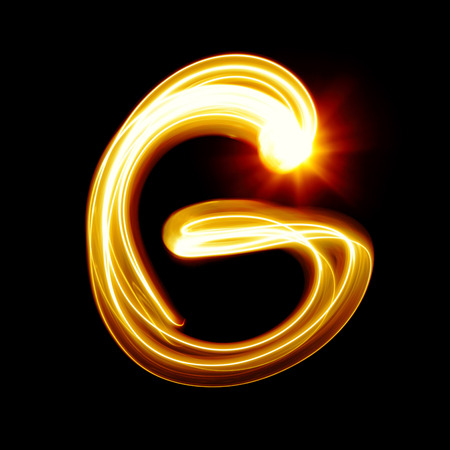 g: Created by light alphabet over black background