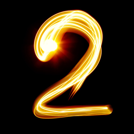 hand written: Two - Created by light numerals over black background