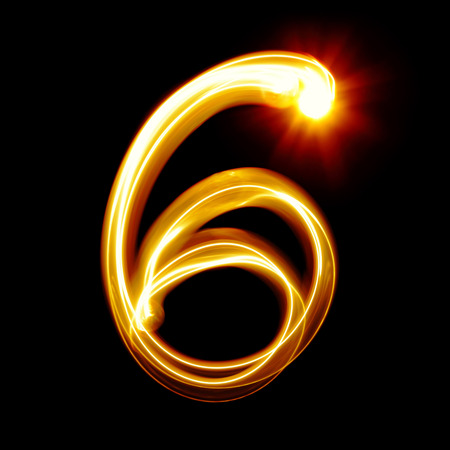 Six - Created by light numerals over black background photo