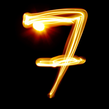 Seven - Created by light numerals over black background photo